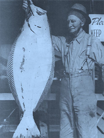 man holding a halibut