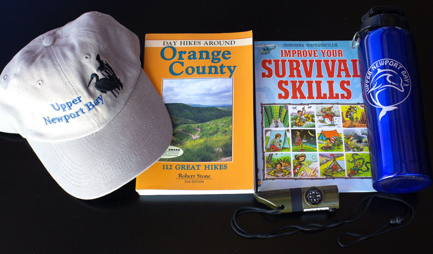 NBC UNB hat, books