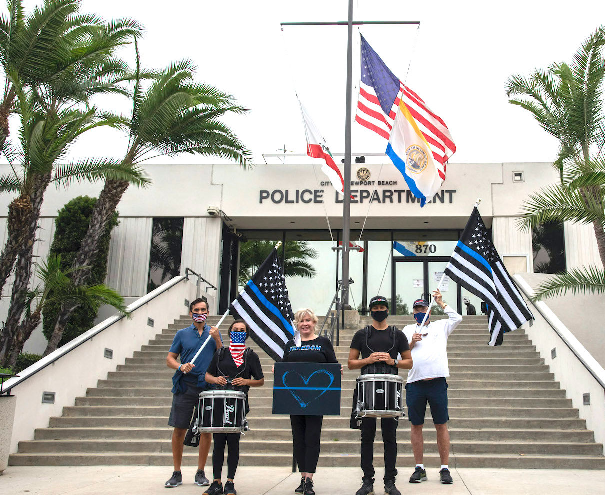 Locals march NBPD headquarters pg